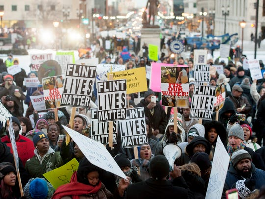 Protestors chant outside the Michigan State Capitol before the State of the State speech, January 19, 2016.