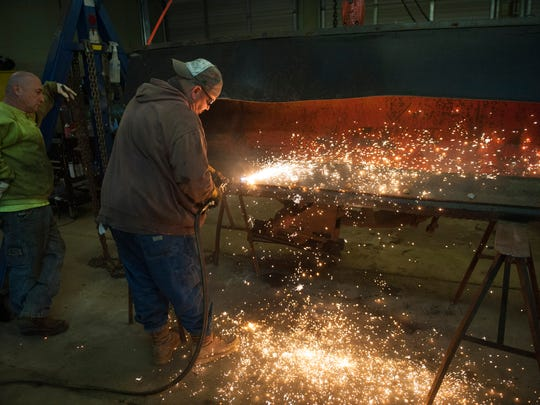 Chip Park, welds a snow plow at the Camden County Department of Public Works in Lindenwold in preparation for this weekend's storm. Thursday, January 21, 2016.