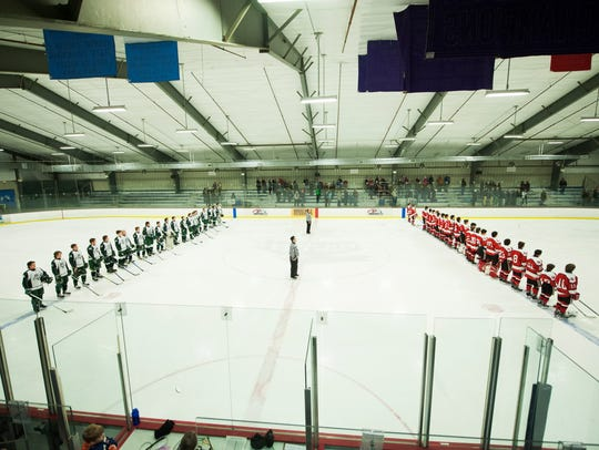 The teams line up to listen to the National Anthem