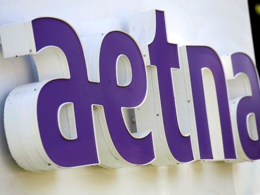 AETNA EARNINGS