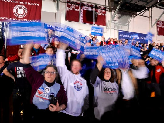 Supporters of Democratic presidential candidate Sen. Bernie Sanders, I-Vt., cheer his victory over former Secretary of State Hillary Clinton on primary election night in Concord, N.H., on Tuesday, Feb. 9, 2016.