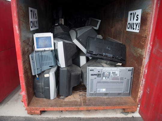 Piles of electronics-- TVs and computers-- at the Gloucester County Recycling Center await recycling.