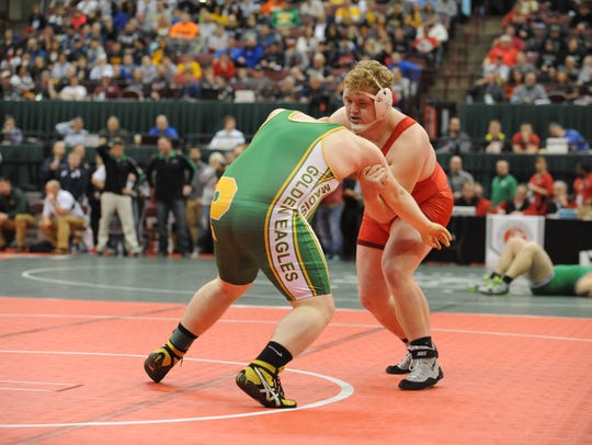 Oak Harbor's Brandon Garber wrestles during the Division