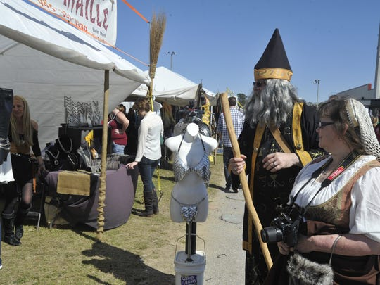 Richard and Mary Angela Niles peruse the vendor booths at the 15th annual Gulf Coast Renaissance Faire Saturday.