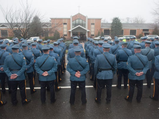 New Jersey State Troopers stand at attention as they