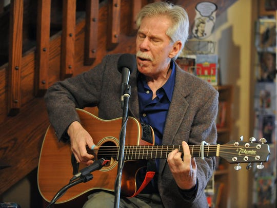 Artist Dan Godbey sang and played music at the new