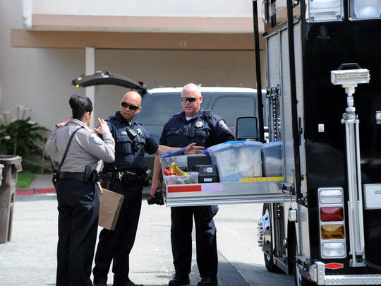 Police working at the scene of Wednesday's fatal shooting at 912 Acosta Plaza in Salinas.