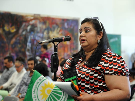 """Acosta Plaza resident Janet Granados speaks to Supervisor Fernando Armenta about health care at the """"#Health4All"""" forum in Salinas on Sunday."""