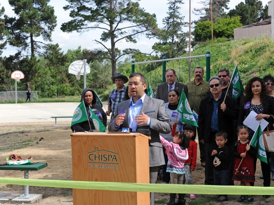 Organizer Joel Hernandez of the Center for Community Advocacy speaks on Thursday at the formal opening of the Acosta Plaza Recreation Area in east Salinas.