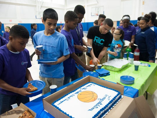 The boys' and girls' basketball teams and cheerleading team at KIPP Cooper Norcross Academy were honored with a pizza party Friday.