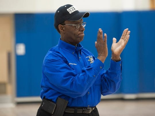 Camden County Sheriff Gilbert 'Whip' Wilson applauds the boys' and girls' basketball teams and cheerleading team at KIPP Cooper Norcross Academy prior to a pizza party Friday.
