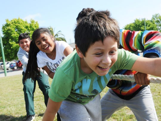 Tug-of-war during First Tee's games on Monday at Jaycee's Tot Lot in east Salinas.