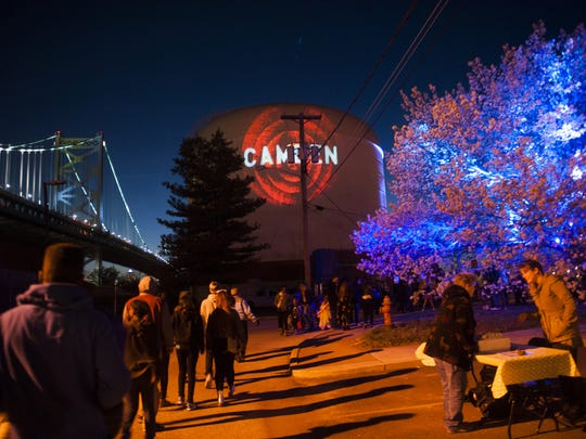 """A scene from the 2014 Camden Night Gardens.  This year, the event's theme is """"Intergalactic Block Party,"""" showcasing all of the light elements characteristic of the Night Gardens."""