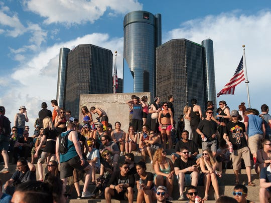 A packed crowd of techno music fans hang out with the Renaissance Center in the background on the second day of the Movement Festival at Hart Plaza in Detroit.