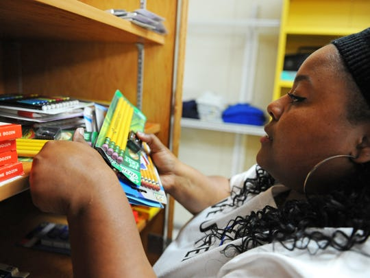 Volunteer Ciquia Martin categorizes essential school supplies for homeless students at Tuesday's Stuff The Bus/MPUSD Family Resource Center kickoff event in Seaside.