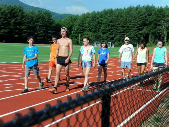 Owen High School's track team completes their workout  on the Black Mountain campus of Montreat College, where a $2 million athletic complex was built in 2015.
