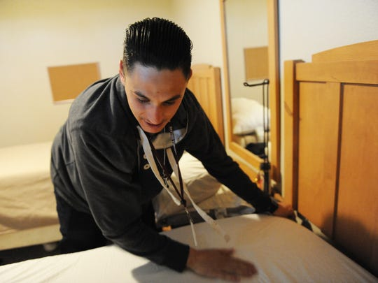 Luis Corona keeps things organized at his transitional housing.