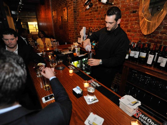 A variety of wines and drinks, like Pisco sours, are served at Pochi Chilean Restaurant in Wilmington.