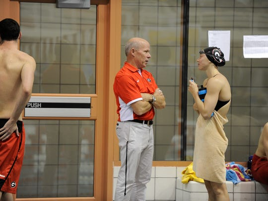 Georgia head coach Jack Bauerle talks to Hali Flickinger during the Bulldogs' swim meet against the Georgia Tech Yellow Jackets at Gabrielsen Natatorium on Wednesday, Nov. 4, 2015 in Athens, Ga.
