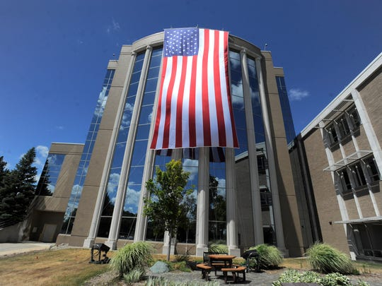 A large 60-by-30 foot American flag draped on the façade of the west wing of the Oakland County Circuit Court building on Friday, July 1, 2016, in Pontiac.