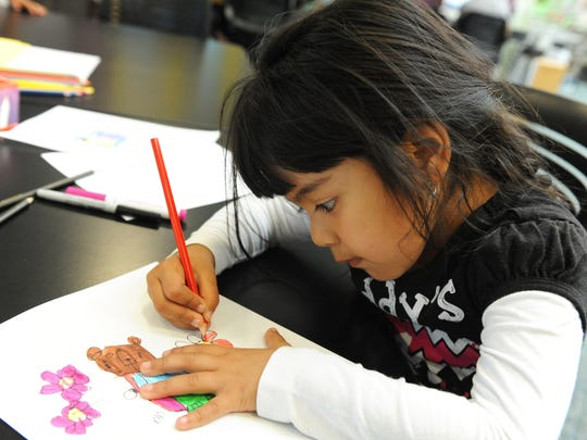 Marie Garduno, 4, enjoys a drawing class for kids at the César Chávez Library in Salinas.