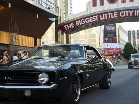 Cars cruise down Virginia Street during Hot August Nights 2014 in downtown Reno.