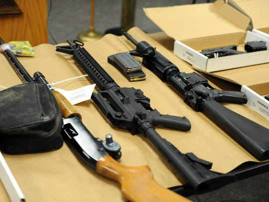 Some of the many weapons recovered by law enforcement shown at a press conference on Wednesday in Salinas. On the far right is the rifle stolen from Salinas Police Chief Kelly McMIllin.