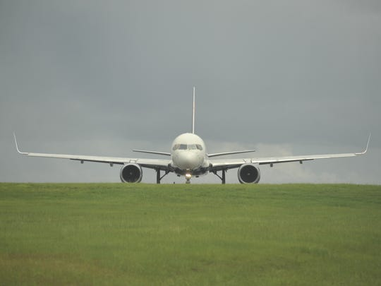 A passenger flight prepares to turn and take off at