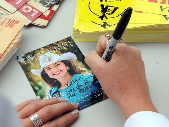 Miss California Rodeo Salinas 2015 Taylor Howell signs autographs for young Belen Tienda, 6, at Tatum's Garden on Sunday.