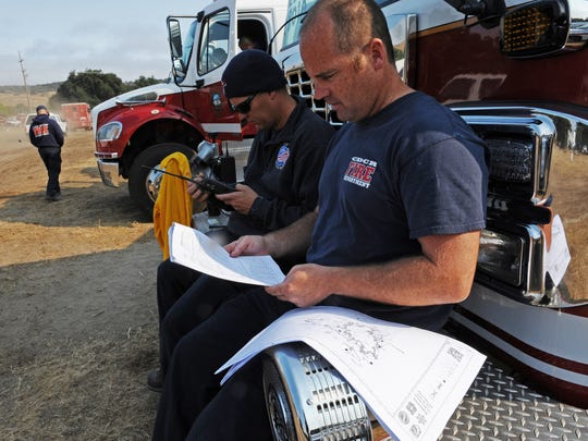 From their base in Toro Park on Thursday, firefighters from the California Department of Corrections and Rehabilitation (CDCR) review their Soberanes Fire strategy.