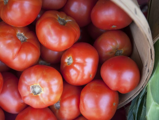Jersey tomatoes smiling from South Jersey farm stands
