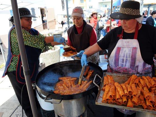 Enchiladas made on the spot are a parish favorite.