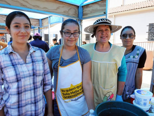 From left, volunteers Aaliyah and Bryanna Salgado, Rosa Izaguirre and Maria Romero working the flautas stall at the festival.