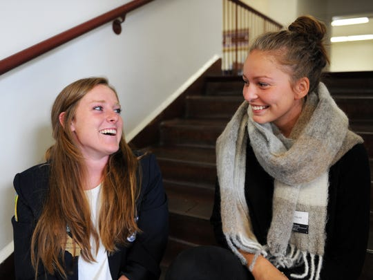 Becca Warwick, left, and Benedikte Hetland on the stairs at Salinas High on Thursday.