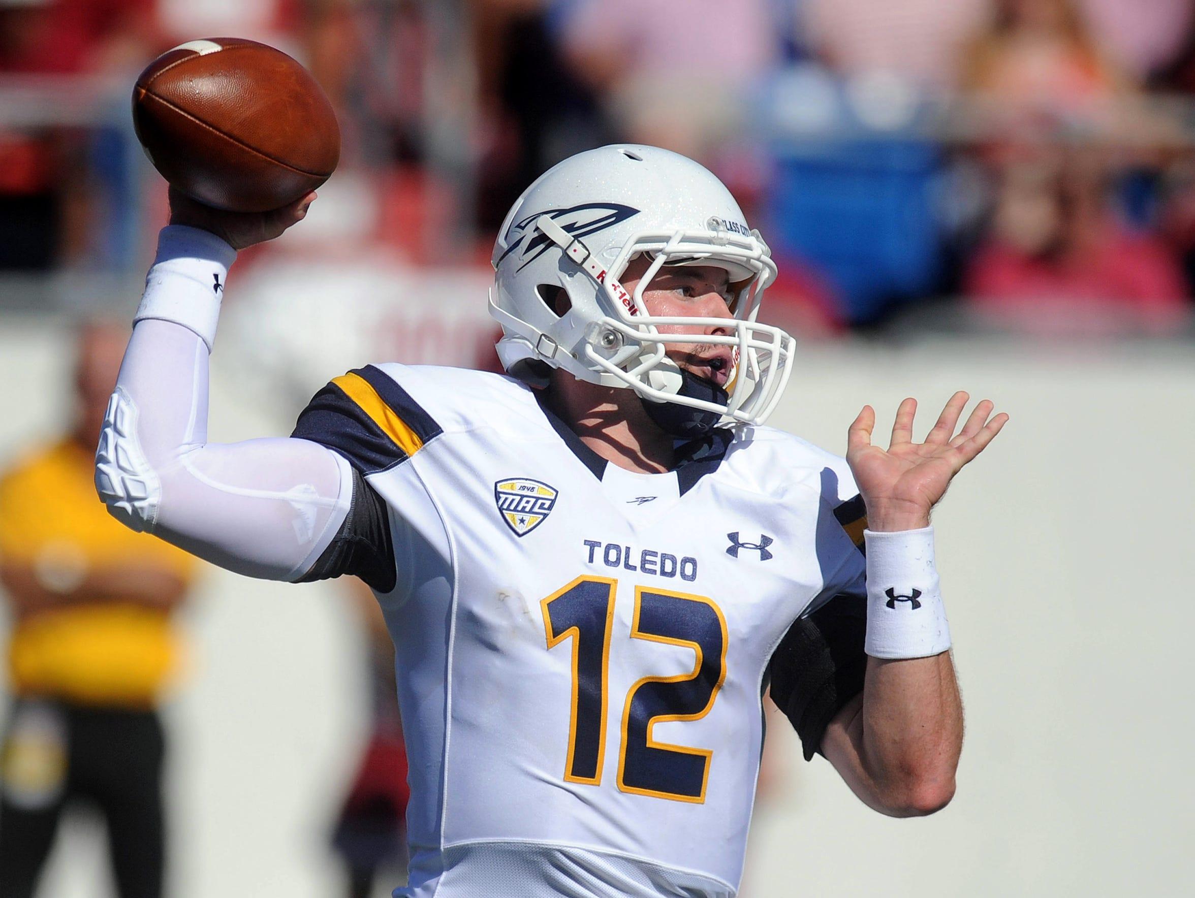 Toledo quarterback Phillip Ely (12) had a mistake-free