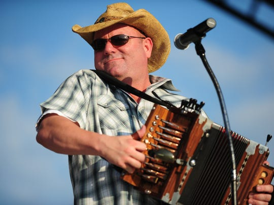 In this file photo, Jamie Bergeron of Jamie Bergon and the Kickin' Cajuns performs during Uniting Acadiana: Festival de Musique.