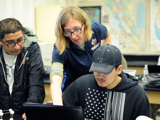 Hartnell instructor Melissa Hornstein helps two engineering