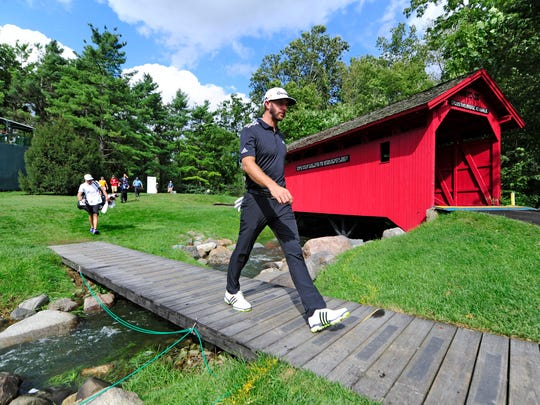Dustin Johnson walks over a bridge on the 7th tee during Saturdays third round of the BMW Championship at Crooked Stick GC.