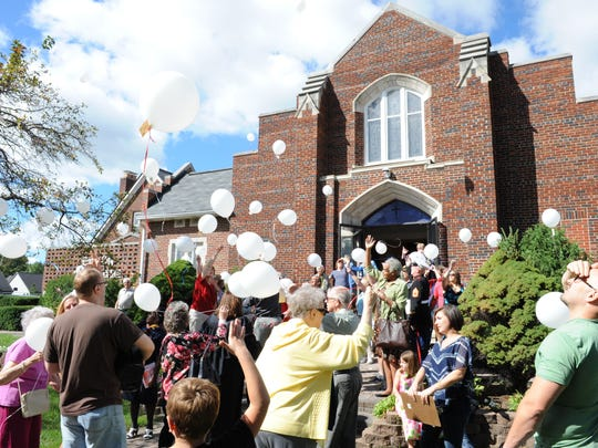 Members of Garden City Presbyterian Church launch balloons