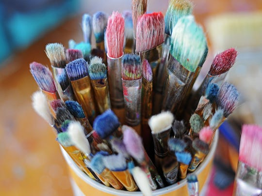 Paintbrushes in Joan Zephier's work space.