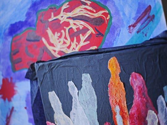 Pieces of art in Joan Zephier's work space.