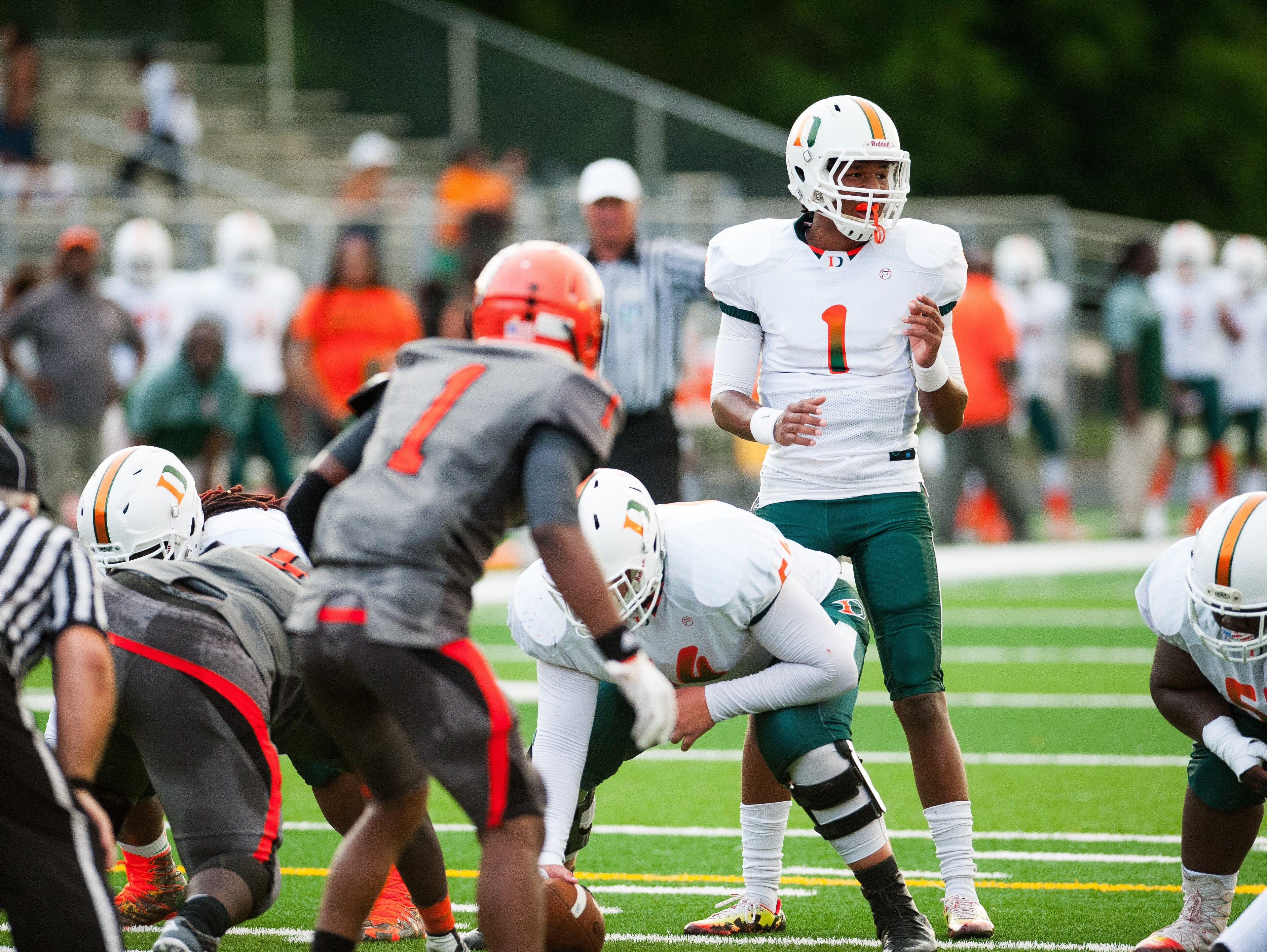 Dunbar junior quarterback Jairus Johnson and the Tigers take on undefeated South Fort Myers on Friday at home.