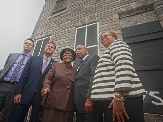 (From left) Haddon Heights resident and civil activist Patrick Duff , Congressman Donald Norcross, former homeowner Jeanette M. Hunt, U.S. Rep. John Lewis, and Camden Mayor Dana L. Redd stand in front of  753 Walnut St., Camden,  a home where Dr. Martin Luther King, Jr. called home during the 1950s.