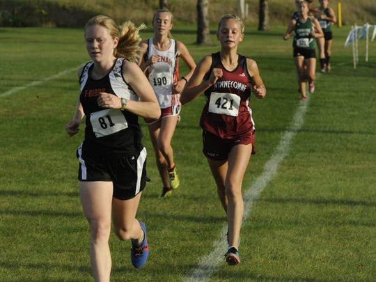 Winneconne's Morgan Fenrich (421) keeps her pace during the Winneconne Invitational on Tuesday.