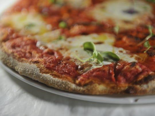 Lockeland Table serves wood-fired pizza.