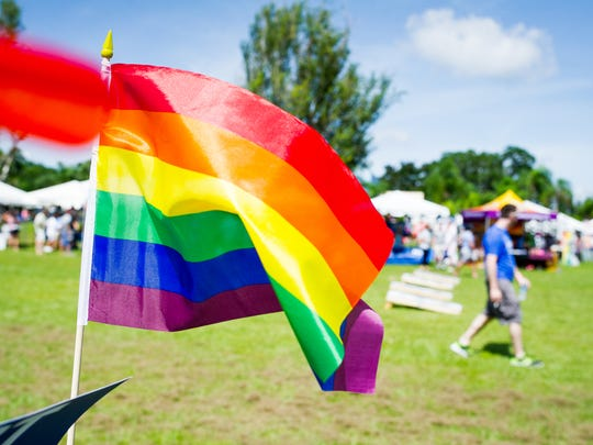 A rainbow flag flaps in the wind during the 8th annual SWFL Pride Festival at the Alliance of the Arts in Fort Myers, Fla., on Saturday, October 8, 2016. Cape Coral is announcing their first LGBT Pride Parade for April 2019.