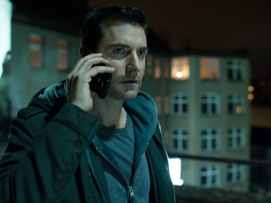 CIA agent Daniel Miller (Richard Armitage) searches