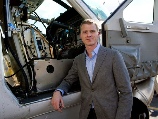 Dan Patt, Program Manager, Tactical Technology Office, Aurora Flight Sciences, stands next to the firms Aircrew Labor In-Cockpit Automantion System (ALIAS), which is mounted in the co-pilot seat of a Cessena Caravan aircraft, at Manassas Airport in Manassas, Va., Monday, Oct. 17. Government and industry are working together on a robot-like autopilot system that could eliminate the need for a second human pilot in the cockpit.