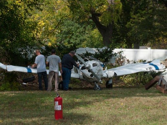 A plane is removed from a Lindenwold yard where it crashed Wednesday afternoon.