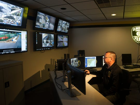 Det. Charles D. Dougherty works at the remote monitoring station at the Gloucester Township Police Department. The unit is helping police keep an eye on parks and other locations.
